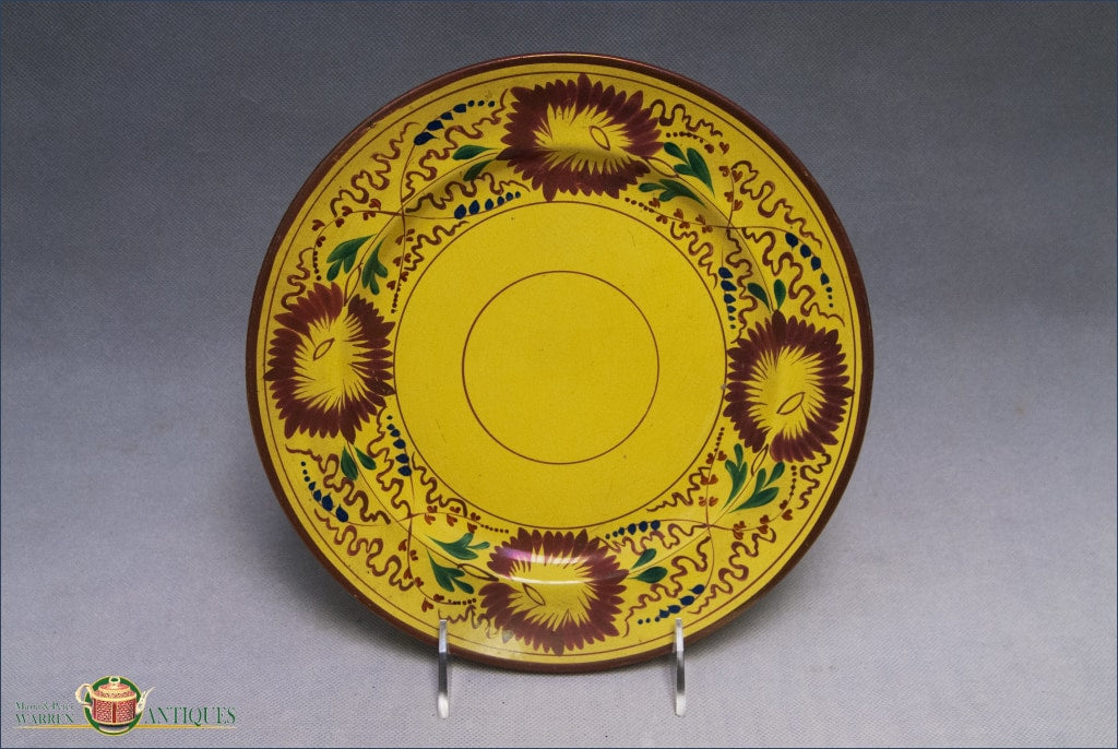 An Antique Creamware Plate in Yellow Glaze decoration from Swansea, c1820