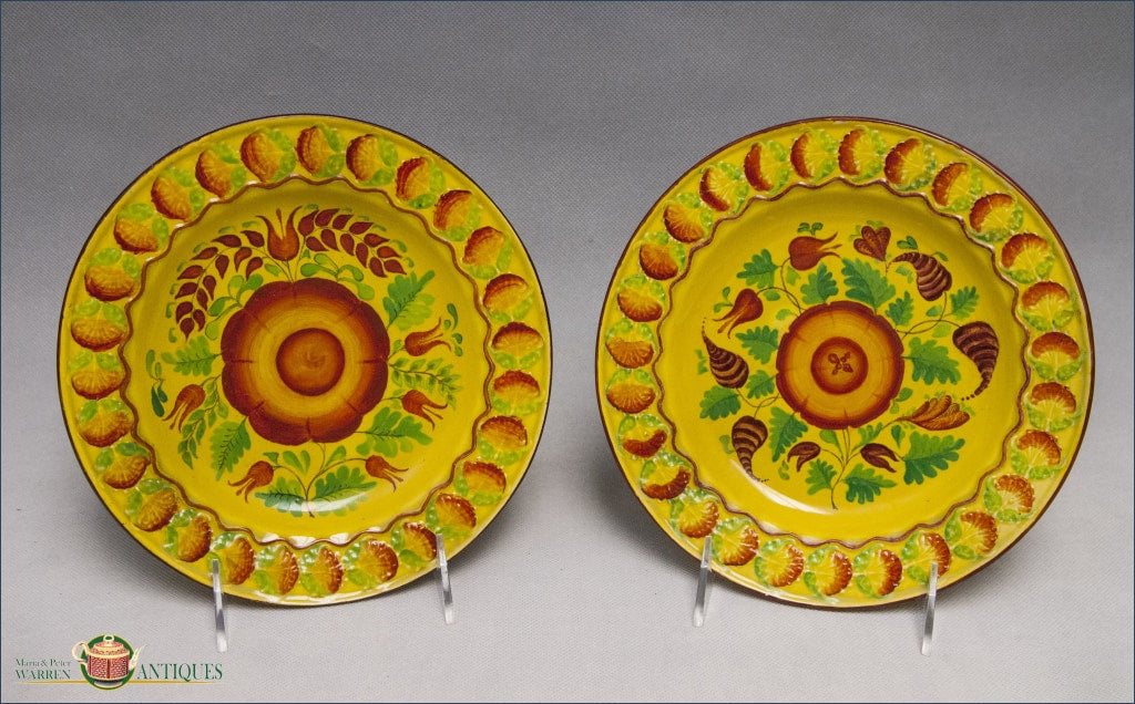 An Assembled Pair Of English Creamware Yellow Glazed Plates With Foliate Decoration C1820 Archive