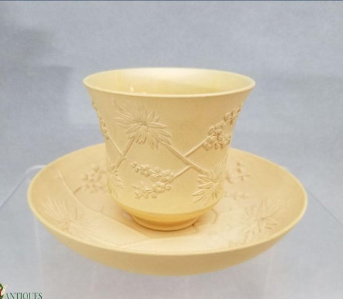 An Antique caneware tea cup and saucer c1810-15 impressed wedgwood mark