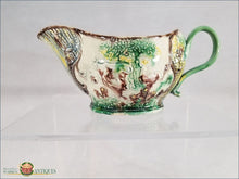 https://warrenantiques.com/products/an-english-creamware-landskip-sauceboat-c1770-80