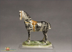 https://warrenantiques.com/products/staffordshire-horse-in-pratt-colors-c1770-80