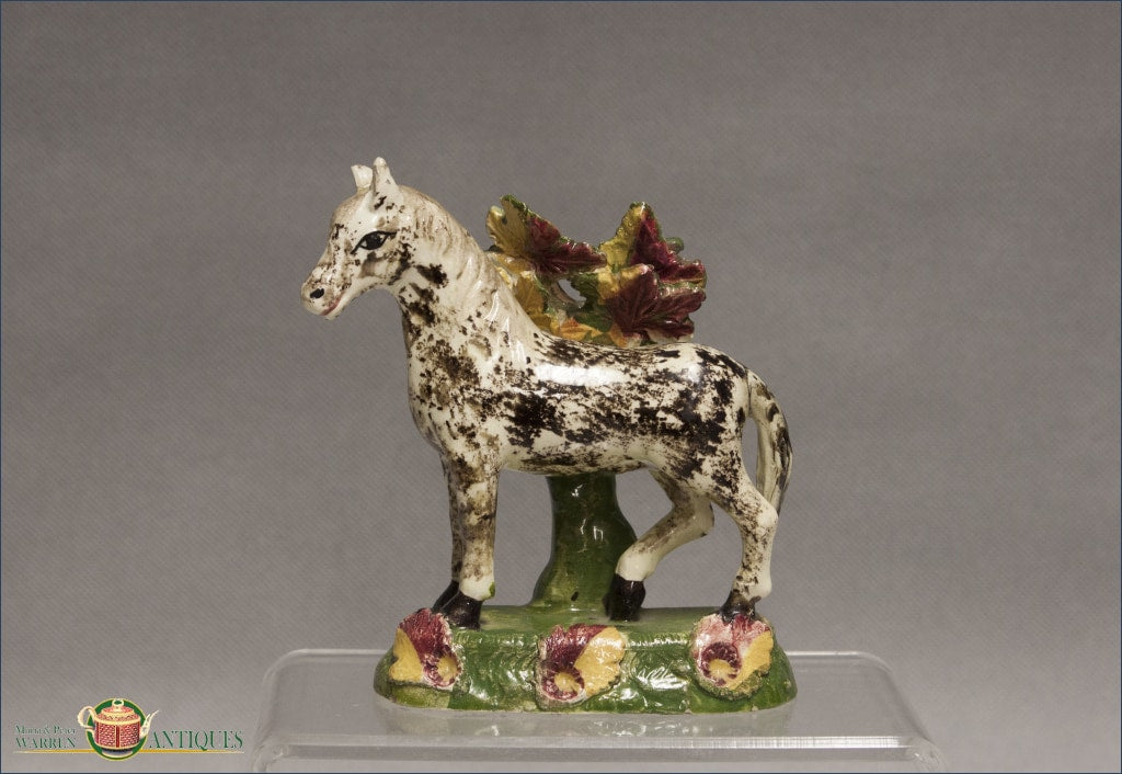 https://warrenantiques.com/products/english-staffordshire-horse-with-bocage-c1840-50