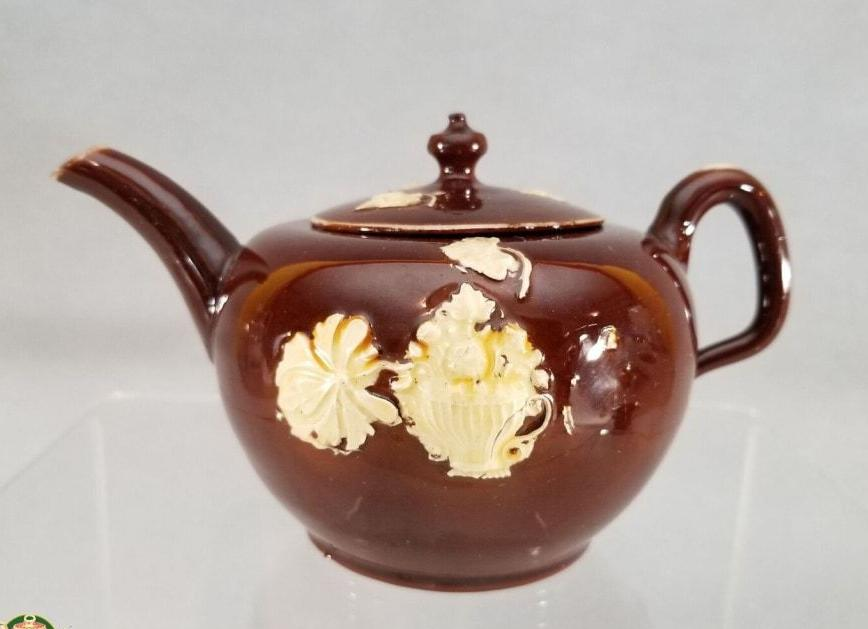 https://warrenantiques.com/products/an-english-staffordshire-glazed-redware-teapot-and-cover-c1740-50