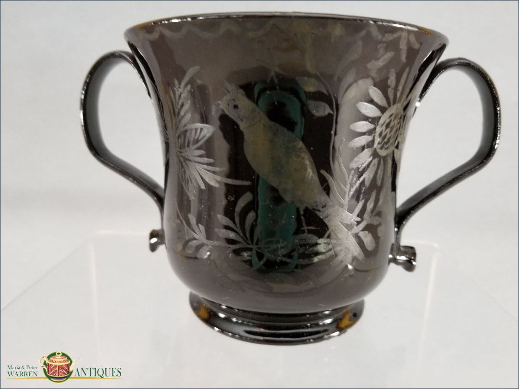 https://warrenantiques.com/products/english-jackfield-loving-cup-decorated-with-a-bird-and-flowers-on-both-sides-c1780-90