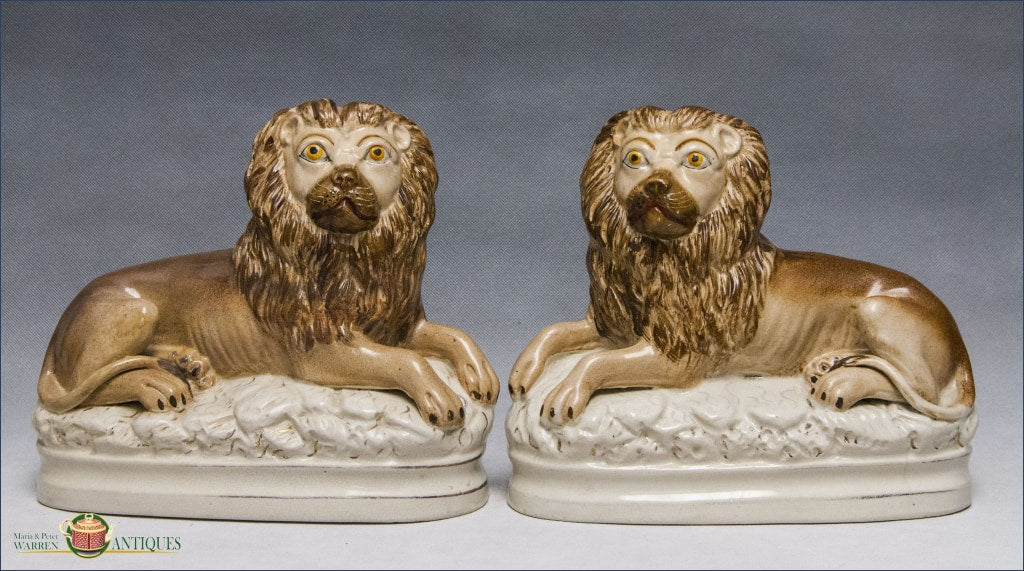 https://warrenantiques.com/products/pair-of-english-staffordshire-recumbent-lions-c1890-1900
