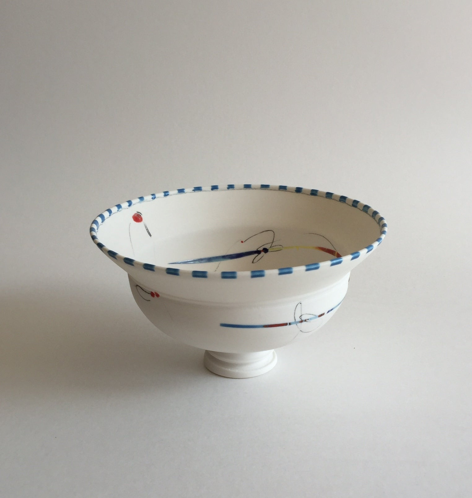 files/VG_14_Bowl_with_spiral_cut_base_blue_checkered_rim_-_Porcelain_Coloured_Glaze_ceramic_Pencil_imagery.jpg