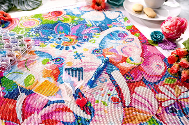 a diamond painting of a pink elephant covered in flowers