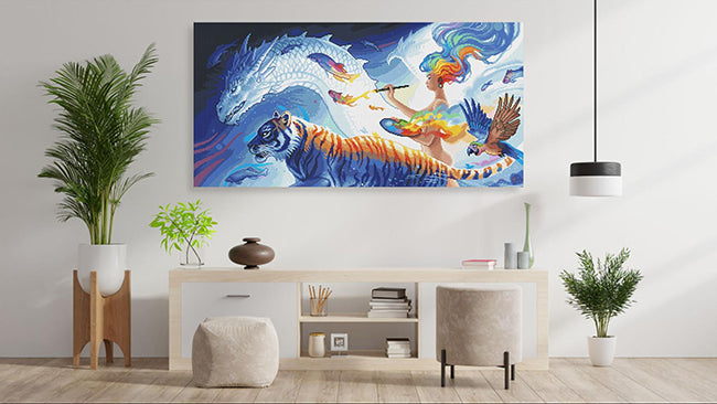 a painting of various creatures coming to life at the end of a goddess' paint brush hanging over desk