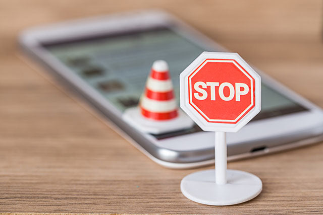 stop sign in front of phone