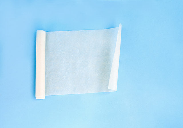 unfolded roll of clean baking paper