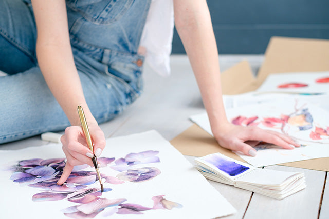watercolor painting on desk