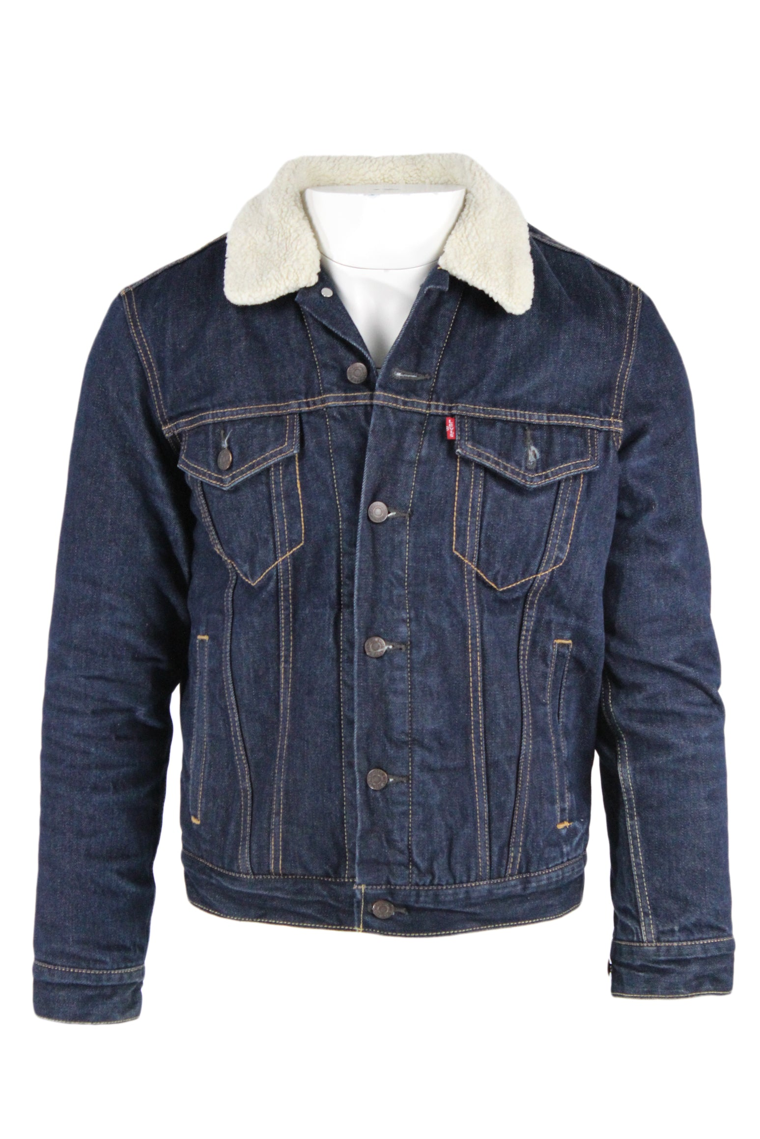 levi's indigo denim jacket with faux sherpa lining. features cream faux sherpa body lining and collar with lightly-filled, lined sleeves. classic 4-pocket front with adjustable waist tabs and contrast topstitching detail throughout. fitted cut, stamped front button closure.