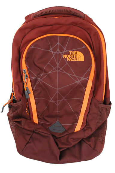 the north face maroon backpack. features maroon exterior with orange trim at zippers and orange embroidered logo. has red interior with pockets on interior and exterior sides. has tonal adjustable straps and perforated back.