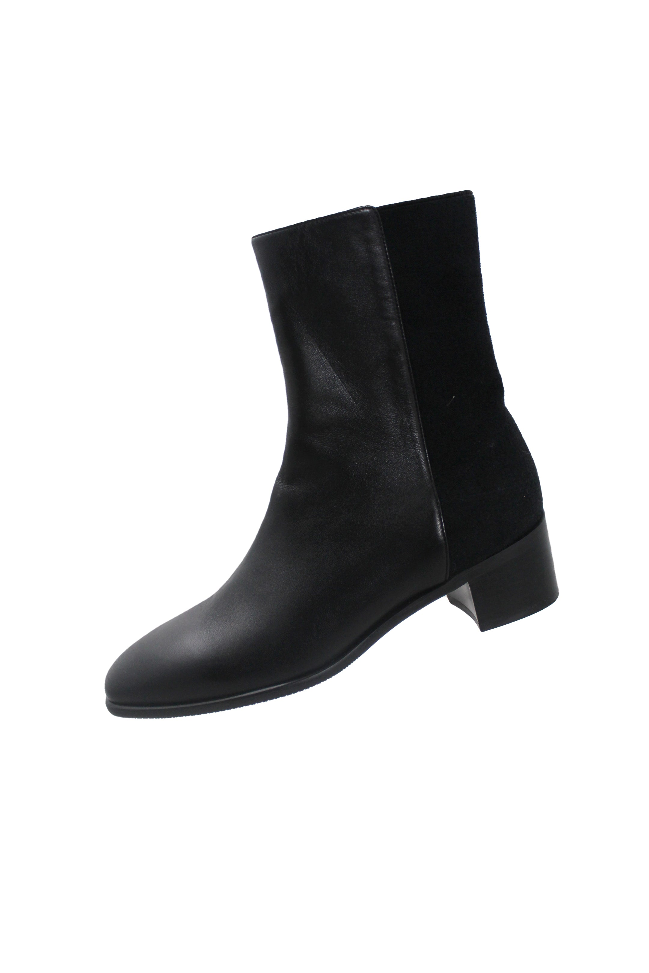 stuart weitzman black leather boots. features black leather exterior with tonal back panel with elastic stretch and block heel.