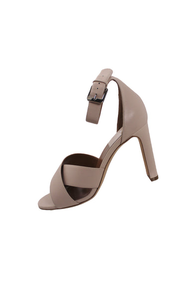 laurence dacade light pink leather heels. features light pink leather exterior, white stitching, silver tone buckle with adjustable closure and tonal open toe wrap style upper.