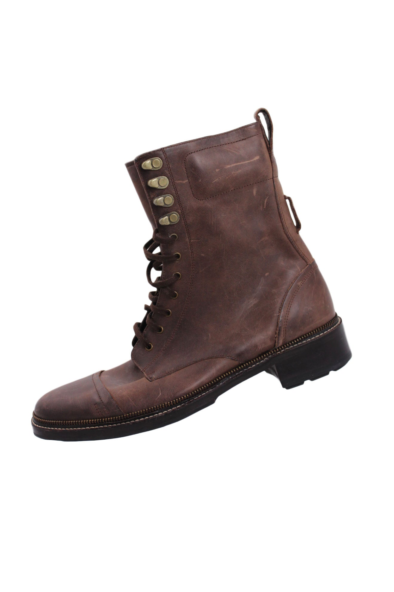 cole haan brown leather cap toe boots. features top flat lace closure, top stitched sole, and a heel measuring at ~ 2.5""