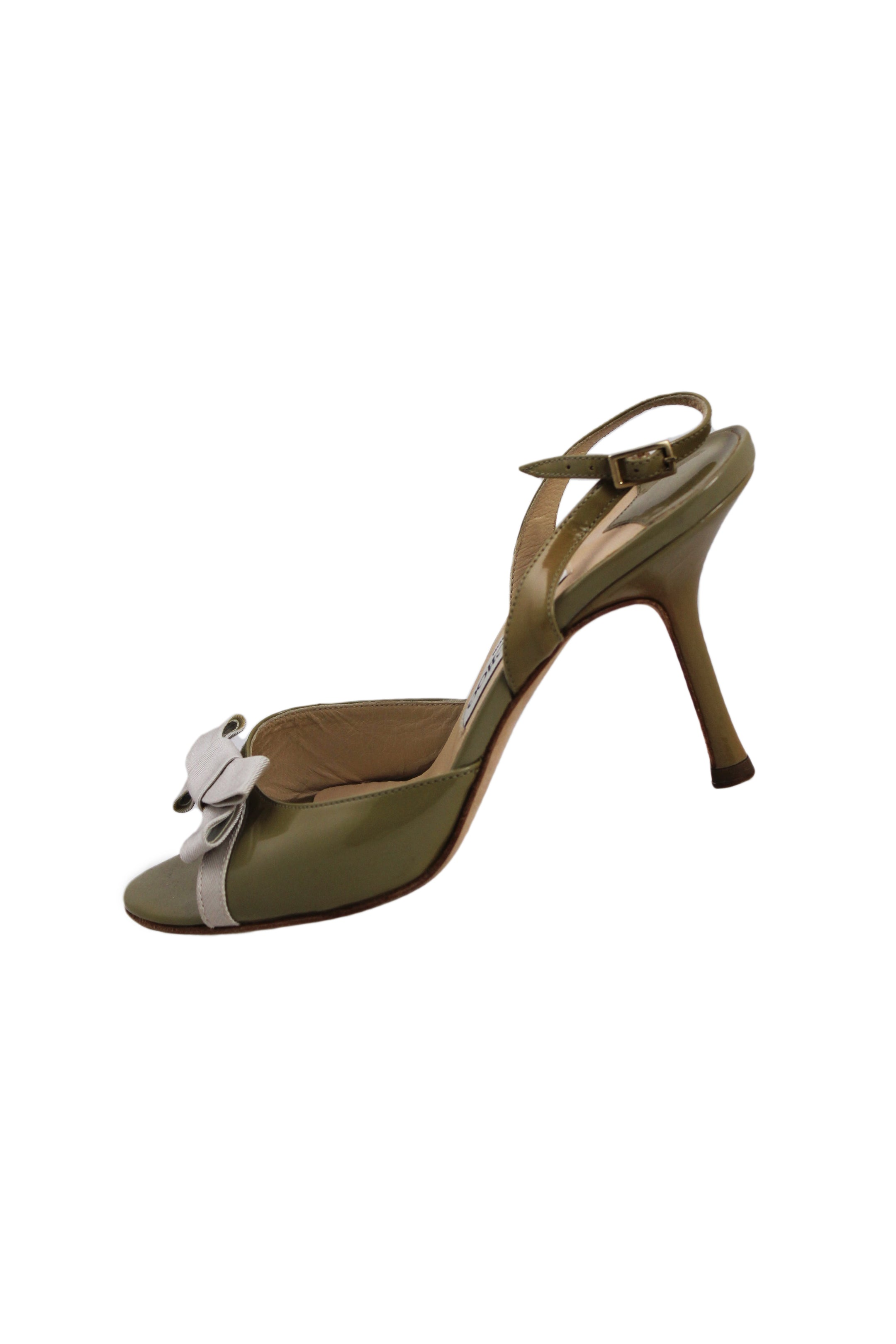 description: jimmy choo green heels. featuring an accent bow detail on toes.