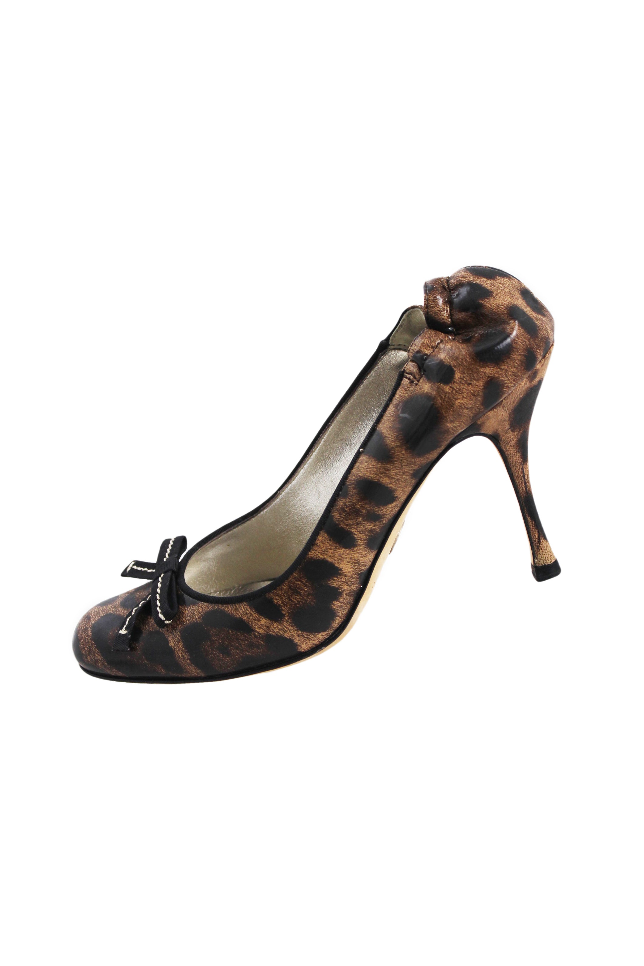 description: dolce & gabbana leopard heels. featuring accent bow on toes and a cinched heel.