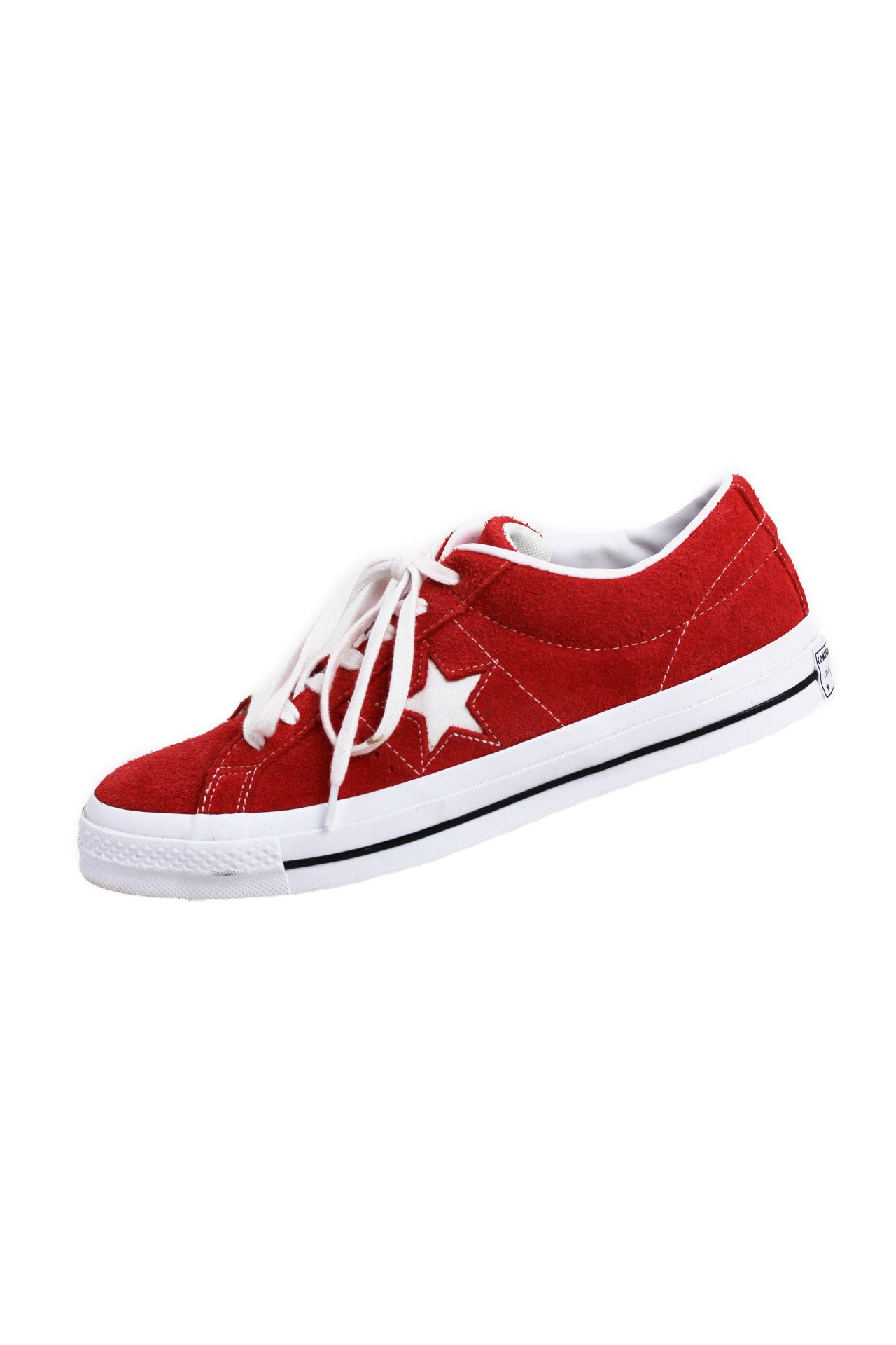 converse red suede low top sneakers. features classic converse red suede upper, white rubber soles, white laces and interior.