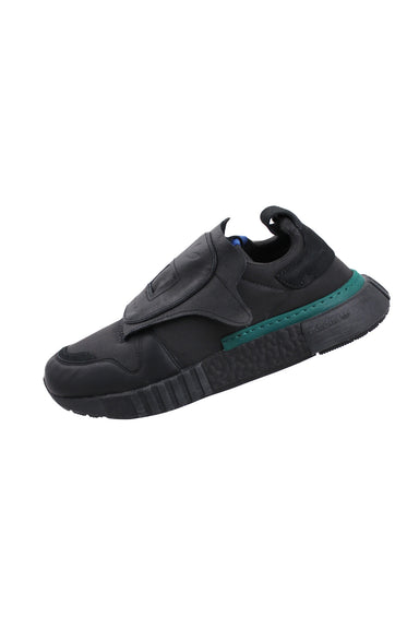 adidas gray/black futurepacer low top sneakers. features velcro closure lace cover, and dark green contrast details.