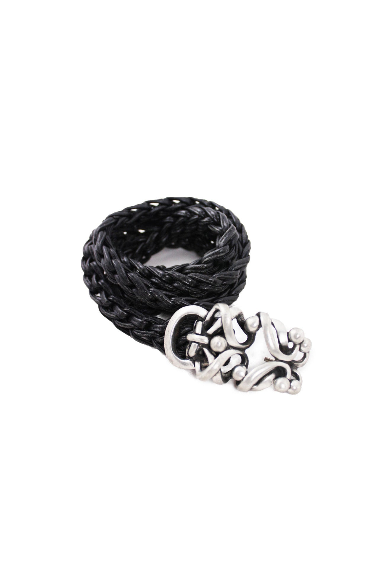 unlabeled black braided silver tone twisted buckle belt. features silver tone twisted buckle with hook closure and black braided exterior.