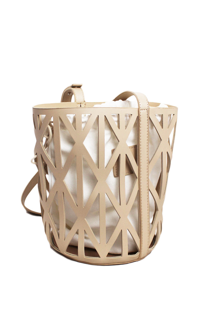 shop-peche beige crossbody/shoulder bag. features an adjustable strap, a removable pouch, and a geometric design shell.