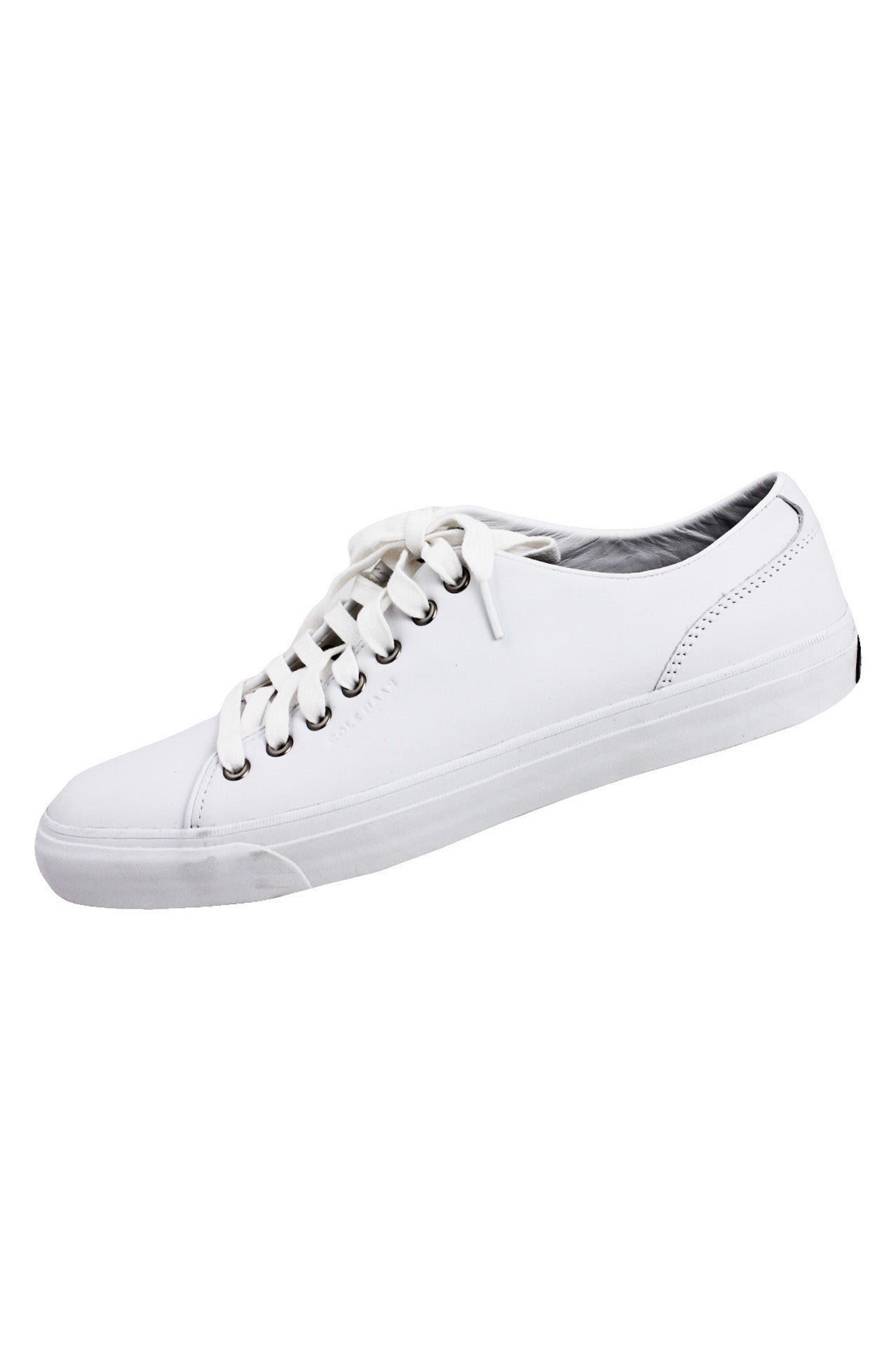 "cole haan grandseries white leather low top sneakers. features tonal design with silver-toned eyelet lace up closure. stamped branding at outer; black and white lobster 'pinch' logo at heel. ~1"" outsole."