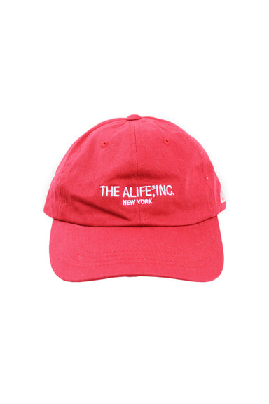 alife red unstructured six panel hat. features branding embroidered at front and left side with adjustable strap/clasp closure at back.