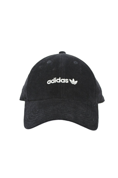 adidas black micro-corduroy 6-panel cap. features white embroidered logo at front and back with adjustable snapback closure. unlined.