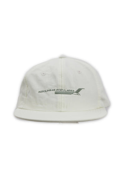 hermanos koumori white unstructured six panel hat. features 'aerolineas populares' graphic embroidered at front with adjustable strap/clasp at back.