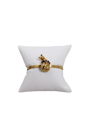 "eva segoura gold tone snail cuff bracelet. featuring 1"" snail with blue detailing."