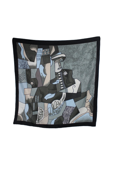 unlabeled printed scarf. features abstract face print and black trim.