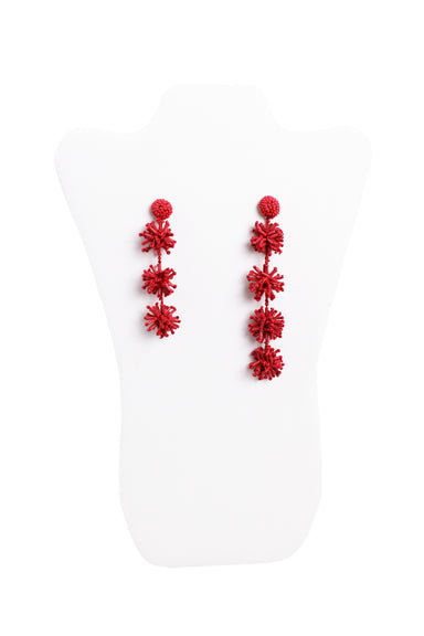 unlabeled red violet asymmetrical drop earrings. features beaded details throughout.