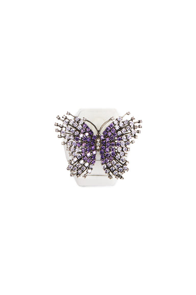 unlabeled silver tone metal butterfly ring. features clear and purple rhinestone details.