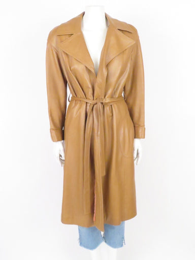 "vintage late 70's-early 80s caramel tone leather trench coat. wrap closure with belted waist. round pockets at sides. sold in ""as is"" condition for signs of wear at lining."