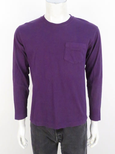 mont-bell purple long sleeve shirt. features 'mont-bell' logo tonal embroidered on left breast pocket. ribbed at collar and cuffs.