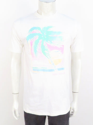 vintage white cotton t-shirt. features 'vero beach' sparkly puffy paint graphic printed at front. ribbed at collar.