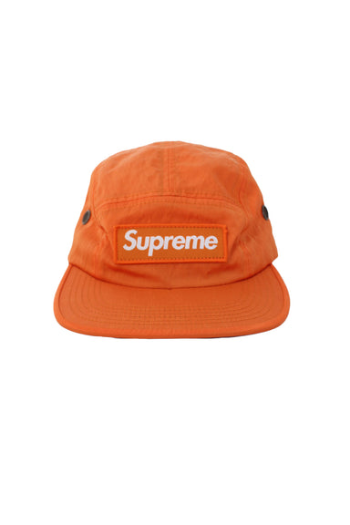 supreme orange unstructured five panel hat. features 'supreme' logo tag at front with adjustable strap/clasp closure at back.