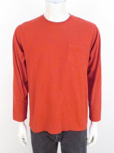 mont-bell burnt red long sleeve shirt. features 'mont-bell' logo tonal embroidered on left breast pocket. ribbed at collar.