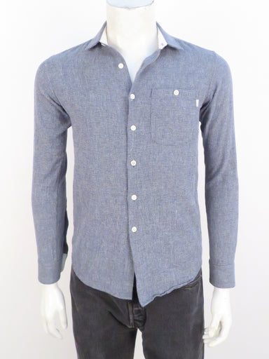 patrik ervell navy/white textured long sleeve button up. features button pocket at left breast.