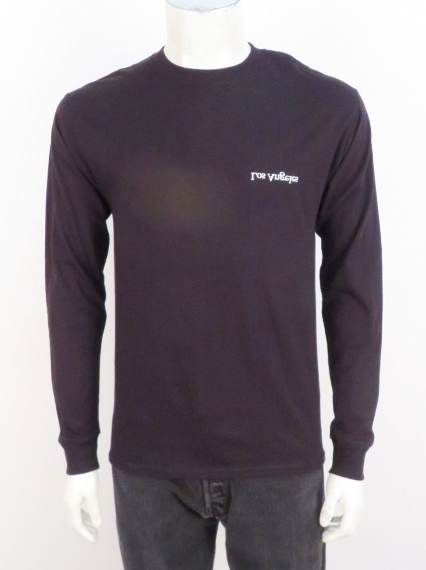 assembly black long sleeve shirt. features 'los angeles' printed upside down and backwards at left breast. ribbed at collar and cuffs.