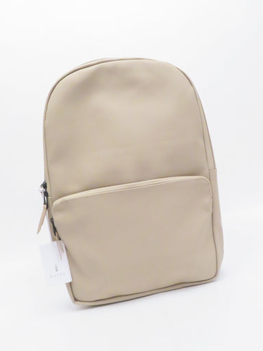 rains beige signature waterproof 'field bag' backpack. features minimalist design with padded shoulder straps and waterproof zippers. lined, padded laptop sleeve. currently retailing for $110.