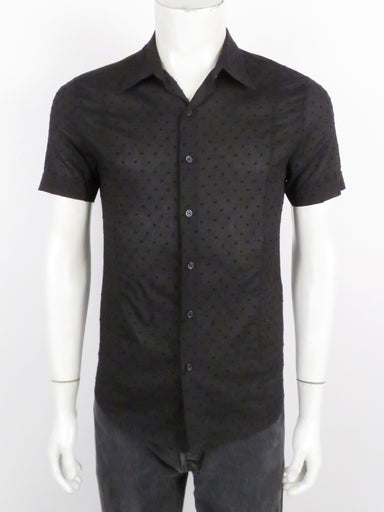prada black short sleeve button up shirt. features 'prada' logo tag at right side above hem. subtle textured pattern throughout.