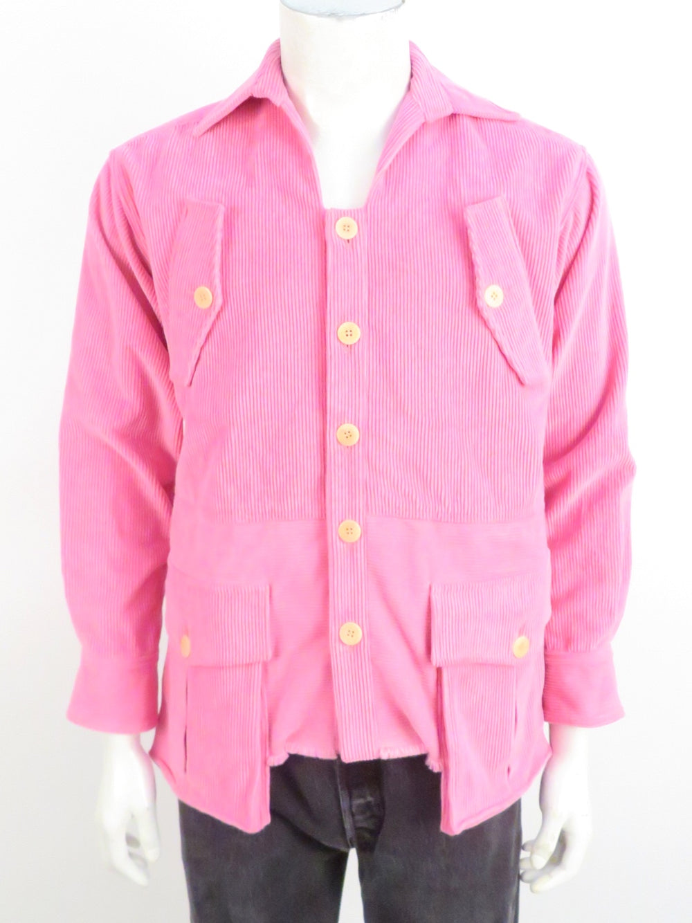 linder pink corduroy jacket. features a cropped raw hemline. front button closure with button flap pockets.