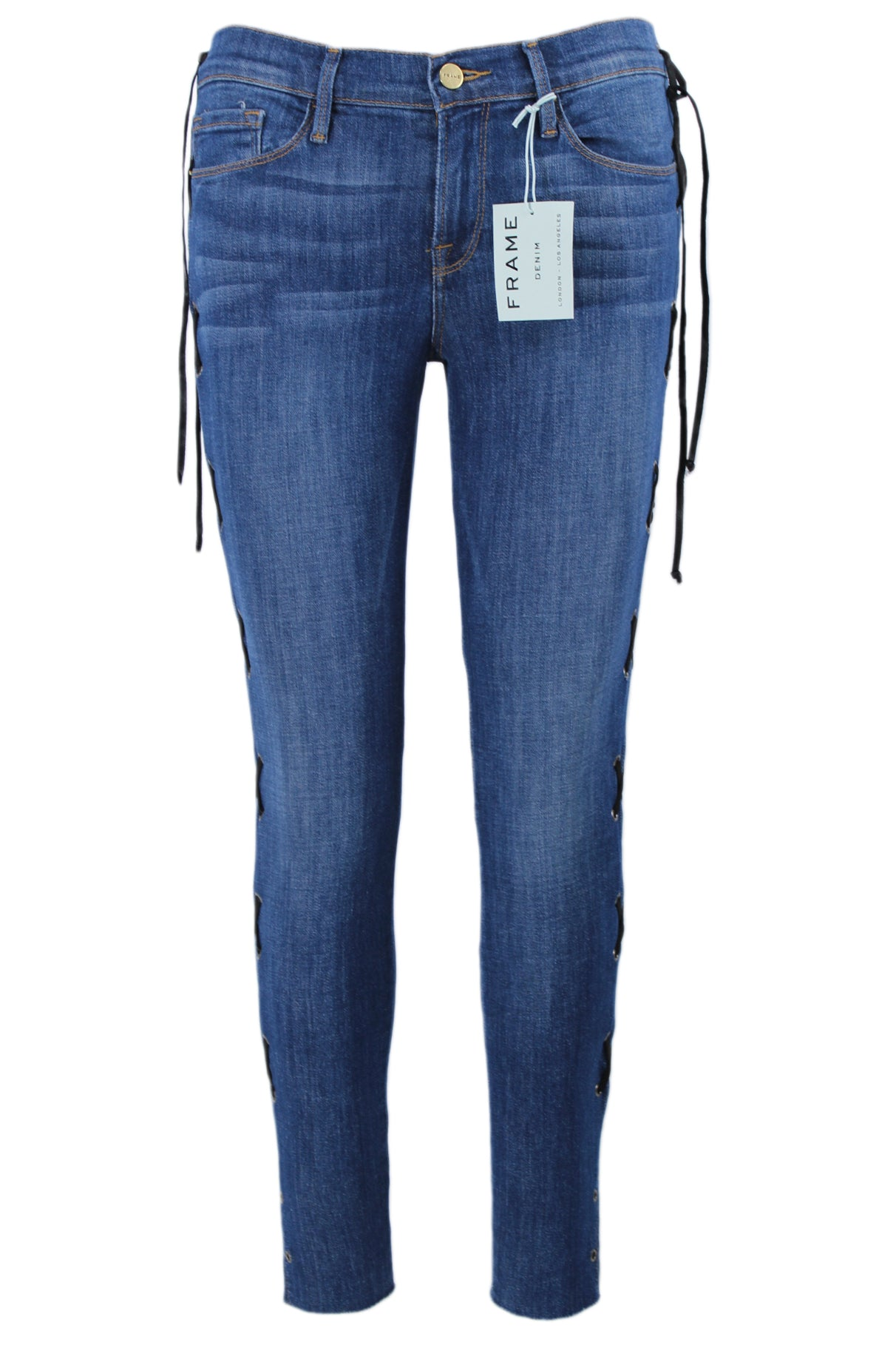 frame indigo high rise skinny jeans. features a concealed zipper & button closure, five external pockets, belt loops, & laced up corset sides. raw bottom hem with small side slits.