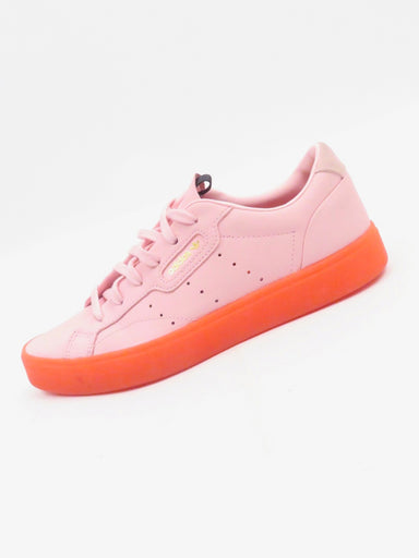 adidas sleek 'diva pink' sneakers. features a smooth pink leather upper. rubber outsole in red. lace up closure. appear to be un