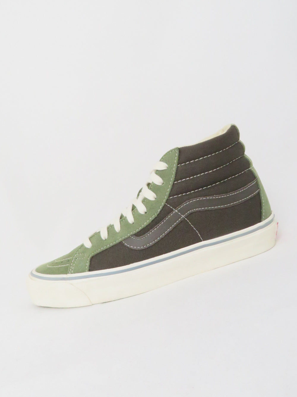 "vans off the wall dark chocolate and sage green classic high top sneakers. features canvas and suede upper with contrast topstitching throughout and branding at tongue and heel. lace-up closure, 1.25"" outsole."