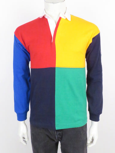 rowing blazers x lands' end red/yellow/green/navy/white colorblock long sleeve rugby shirt. features a logo patch at left sleeve .three button placket.