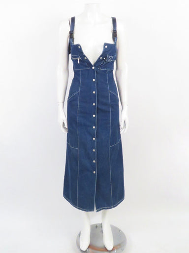 "description: vintage tommy jeans denim dress. fitted silhouette. snap button down front closure. pockets at sides, chest, and rear. adjustable straps.   color: dark denim  size: extra small  chest: 30"" waist: 25""  fabrication: 75% cotton, 25% polyester  condition (all items are secondhand): good pre-owned vintage condition  country of origin: hong kong"