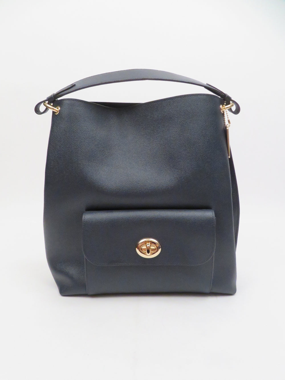 coach black leather tote. features small exterior pouch and large interior main compartment, handle.